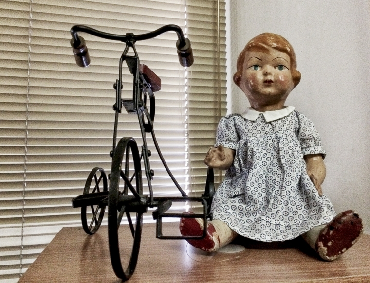 doll with bike